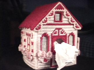 Cottage in pink front left
